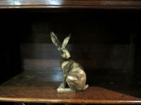 A seated hare figure,