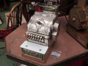 A National Cash Register, nickel plated case, model 348, serial no. 943030, made in 1911.