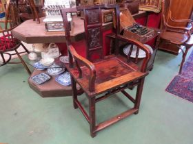 An elm Chinese armchair with carved panel central splat,