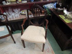 """Retailed at """"Harrods"""" a George III style mahogany shield-back elbow chair on square tapering legs"""