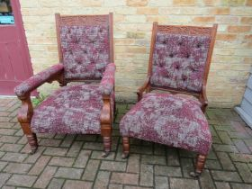 A pair of Victorian walnut his and hers armchairs,