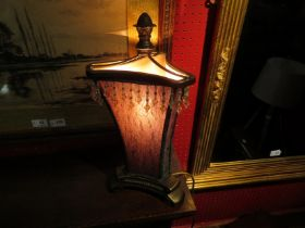 A table lamp with embroidered shade and beaded fringe