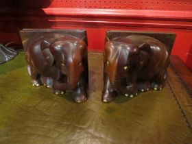 A pair of carved wooden elephant bookends
