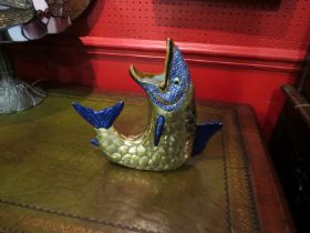 A brass and ceramic fish vase,