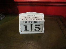 A wooden perpetual calendar