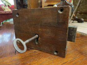 An oak door lock with key