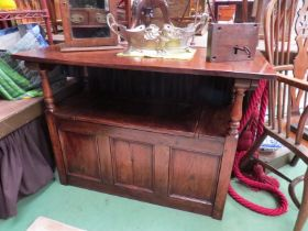 An 18th Century revival oak Monks bench the drop down table top over a hinged seat box seat settle