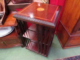 A Georgian style crossbanded inlaid mahogany revolving bookshelf on castors,