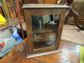 An early 20th Century oak smokers cabinet with two internal drawers