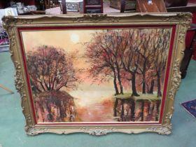A naive oil of trees beside lake at sunset, ornate gilt framed,