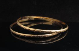 Two gold bangles, one repaired, unmarked, 7.2g