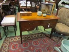 A Circa 1900 inlaid and crossbanded mahogany four drawer side table,