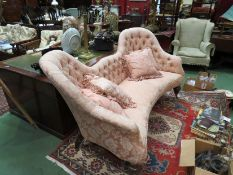 A double humpback sofa with button back and cushions,