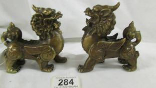 Well cast pair of Chinese feng shui very detailed kylin statues. Height 12cm and 11cm.