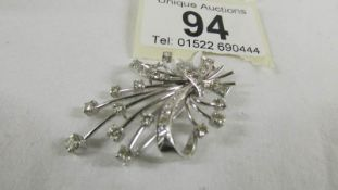 An 18ct white gold and diamond floral spray brooch.