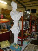 A plaster female bust on pedestal, a/f.