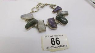 A multi stone set bracelet in silver.