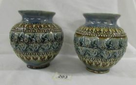 A pair of lovery 15.5 cm Doulton Lambeth bowls with various markings on base of each.