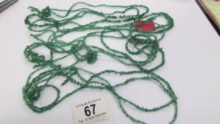 Four long rows of emerald beads, approximate length per strand 4.5 feet.