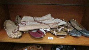 4 pairs of vintage oriental slipper and a corset.