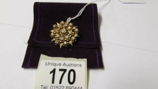 An 18ct gold and diamond pendant/brooch.