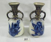 A pair of Doulton Burslem 'Faience' 22 cm tall vases with shoulder cream and blue gilding,