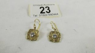 A pair of 9ct gold earrings, 3 grams.