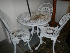 A garden table and 3 chairs.