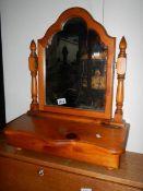 A pine toilet mirror.
