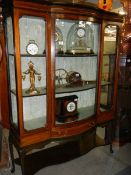 An Edwardian mahogany inlaid display cabinet with domed glass door.