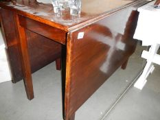 A good solid Victorian mahogany drop leaf table. ****Condition report**** 105.