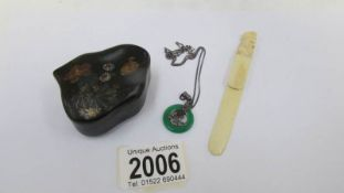 A Chinese lacquered snuff box with bird decoration, an ivory book mark and a jade necklace.