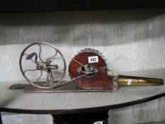 A rare Victorian handle wind brass and wood bellows.