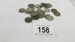 24 silver coins with holes in, 38 grams.