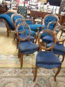 A mahogany salon suite comprising chaise longue, ladies chair,