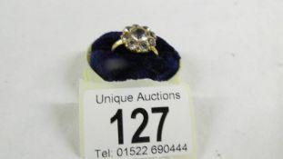 A cluster ring size O, (tests as 24ct gold).