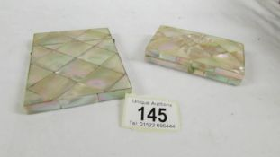 2 19th century mother of pearl card cases.