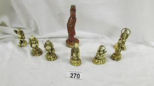 7 miniature Chinese figures and one other.