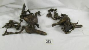 An unusual pair of Benares Mughal-style bronze hanging 'diya' oil lamps with chains,