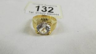 A ring set white stone (tests as 24 ct gold) size S.