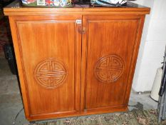 A top quality Chinese style cocktail cabinet.