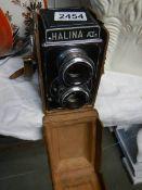 A cased vintage Halina camera.