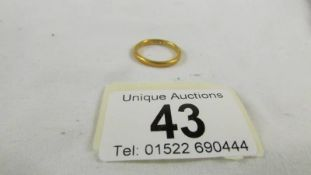 A 22ct gold wedding ring, size L, 3.5 grams.