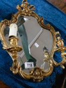 A gilt frame wall mirror with lights (will need rewiring).