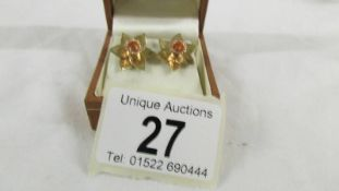 A pair of 9ct gold earrings fashioned as daffodils. 4.5 grams.