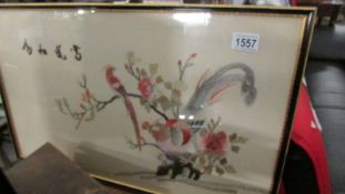 A framed and glazed Chinese embroidery.