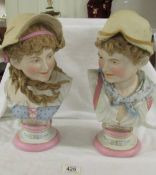A pair of continental bisque busts of boy and girl both marked 709 over 27.
