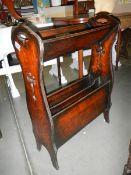 An arts and crafts oak book rack.