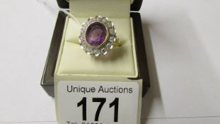 An 18ct gold diamond and amethyst ring, size N.