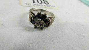 A 9ct gold cluster ring, size O.